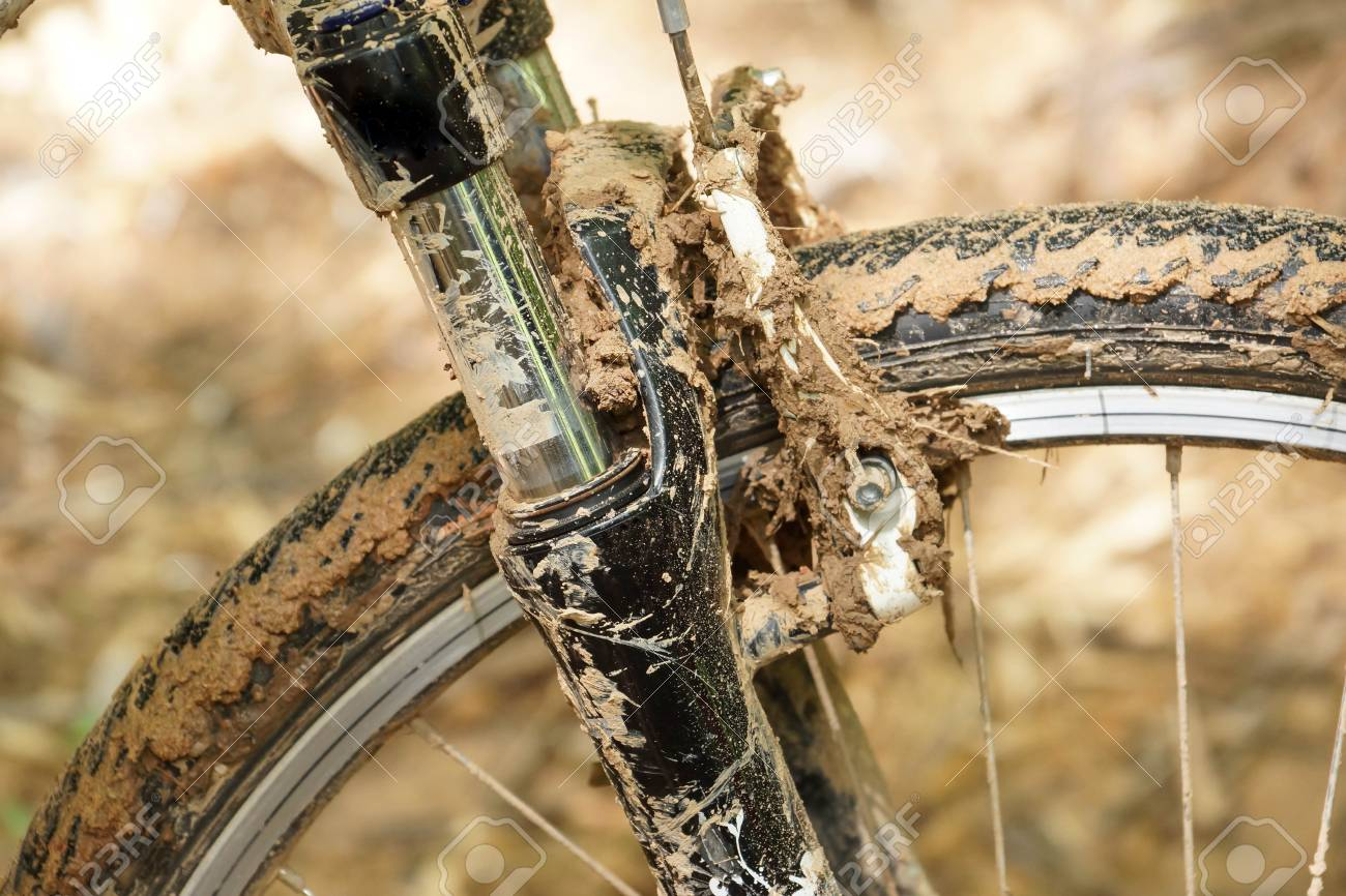 80823455-mountain-bike-wheel-brake-and-suspension-fork-covered-with-mud-riding-a-bike-through-...jpg