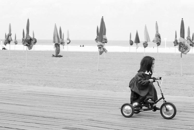 girl-on-tricycle-Deauville-France.jpg